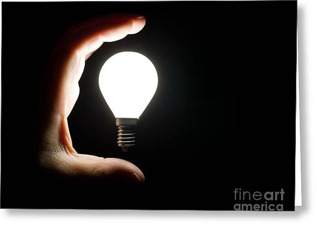 Light Bulb And Hand Greeting Card by Simon Bratt Photography LRPS