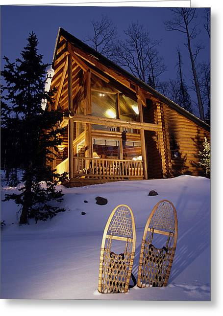 Lighted Cabin With Snowshoes In Front Greeting Card