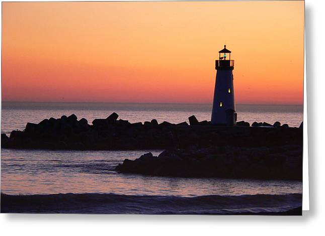 Lighthouse At Sunset Greeting Card by Jeff Lowe