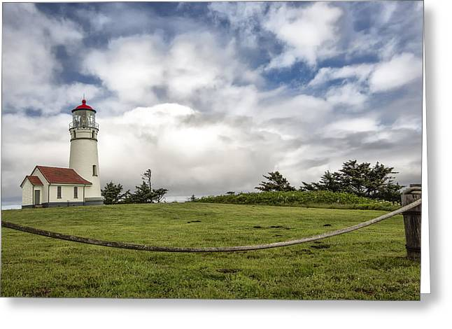 Lighthouse In The Clouds Greeting Card by Jon Glaser