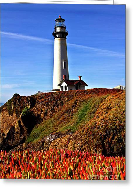 Lighthouse With Red Blooms Greeting Card