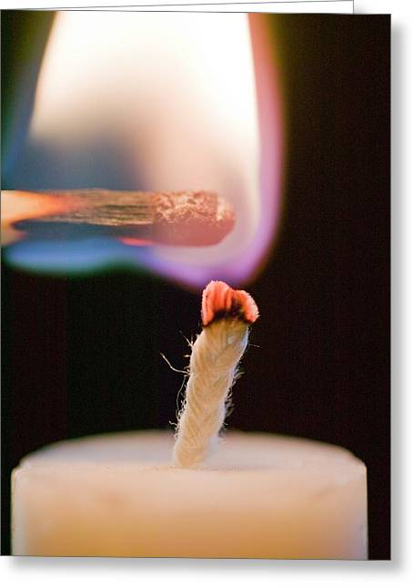 Lighting A Candle With A Match Greeting Card by Ashley Cooper