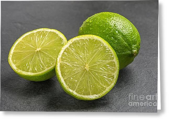 Limes On A Slate Plate Greeting Card by Palatia Photo