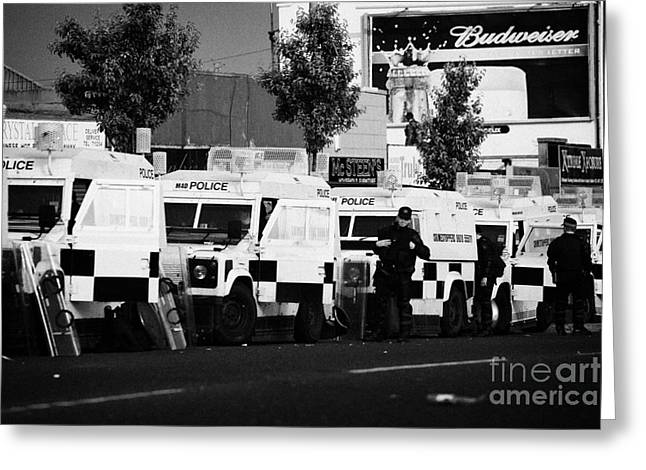 Line Of Psni Landrovers And Officers On Crumlin Road At Ardoyne Shops Belfast 12th July Greeting Card