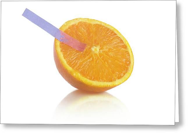 Litmus Paper Test On An Orange Greeting Card
