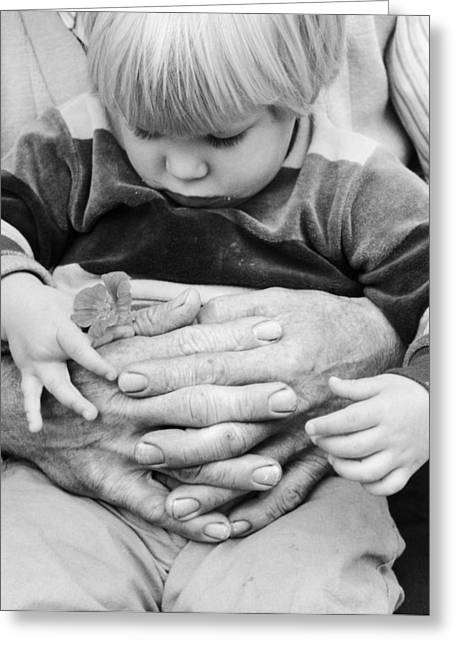 Little Boy In Grandfathers Arms, C.1980s Greeting Card by Photo Media/ClassicStock