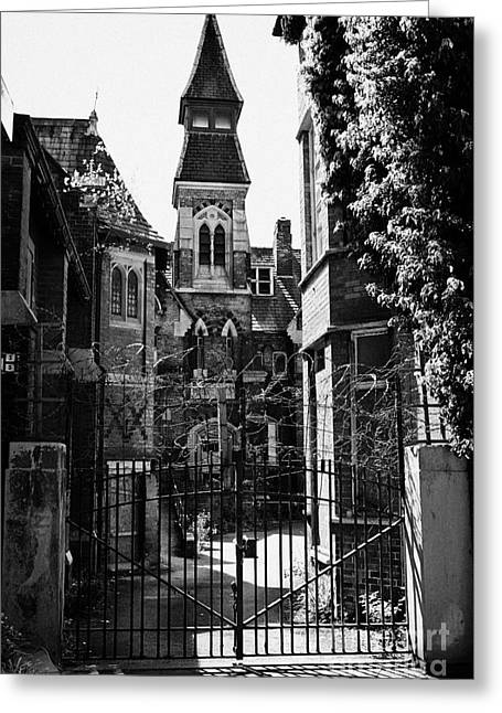 locked gates at old st josephs orphanage building Preston Lancashire UK Greeting Card