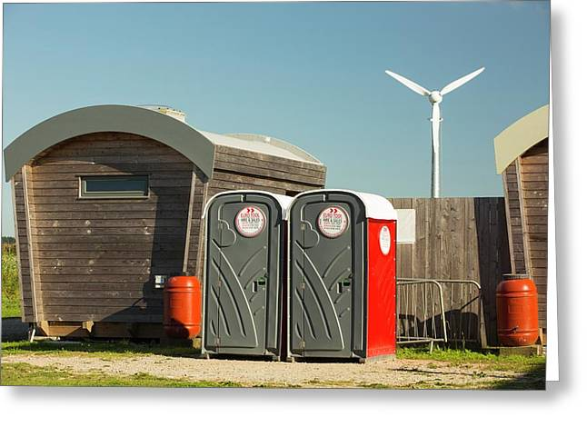Log Cabins And A Wind Turbine Greeting Card by Ashley Cooper