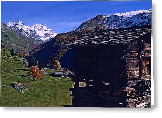 Log Cabins On A Landscape, Matterhorn Greeting Card by Panoramic Images