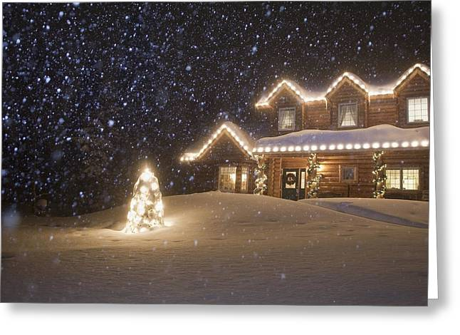 Log Home Decorated With Christmas Greeting Card by Jeff Schultz