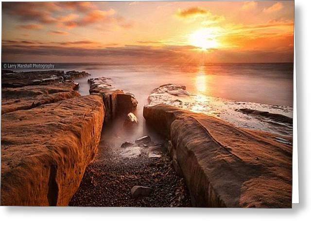 Long Exposure Sunset At A Rocky Reef In Greeting Card by Larry Marshall