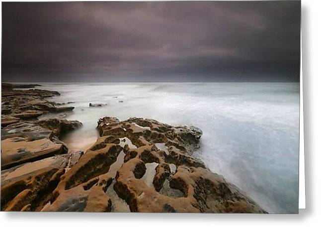 Long Exposure Sunset On A Dark Stormy Greeting Card by Larry Marshall