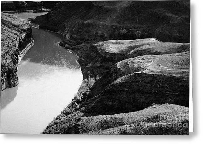 looking down helipads and the colorado river bottom of the grand canyon Arizona USA Greeting Card by Joe Fox