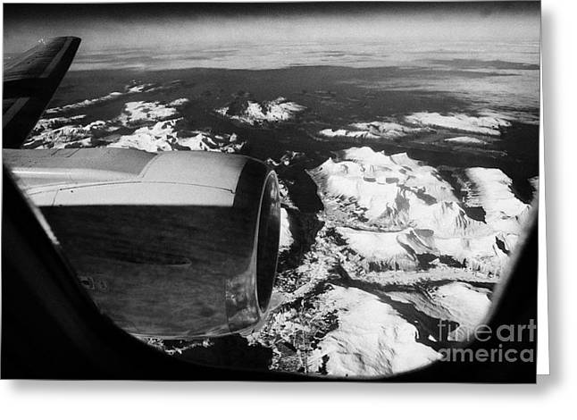 Looking Out Of Aircraft Window Over Engine And Snow Covered Fjords And Coastline Of Norway Europe Greeting Card by Joe Fox