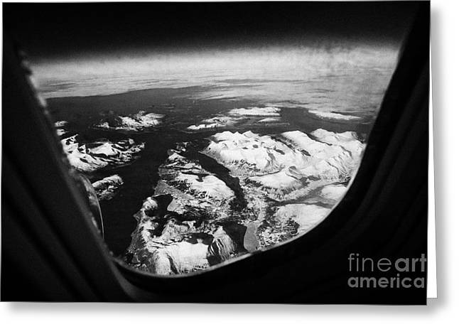 Looking Out Of Aircraft Window Over Snow Covered Fjords And Coastline Of Norway  Greeting Card by Joe Fox