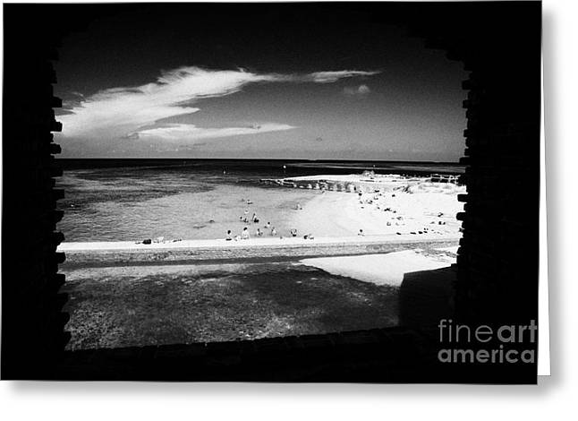 Looking Out Of Brick Archway Towards Tourists On The Beach Fort Jefferson Dry Tortugas National Park Greeting Card by Joe Fox
