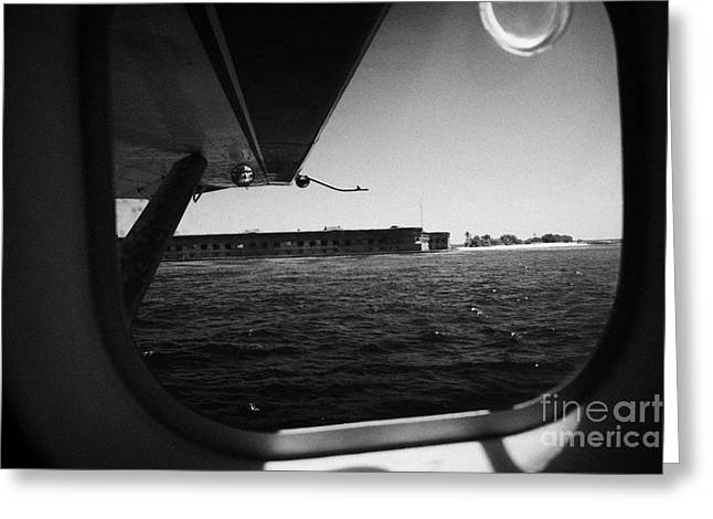 Looking Out Of Seaplane Window Coming In To Land On The Water In A Seaplane Next To Fort Jefferson G Greeting Card