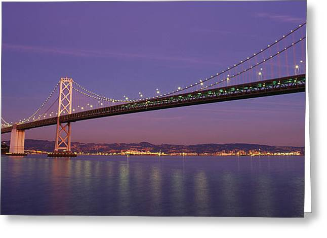 Low Angle View Of A Bridge At Dusk Greeting Card by Panoramic Images
