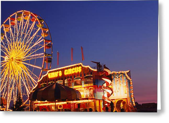 Low Angle View Of A Ferries Wheel Lit Greeting Card by Panoramic Images