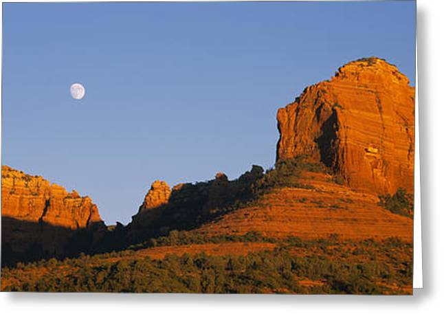 Low Angle View Of Moon Over Red Rocks Greeting Card