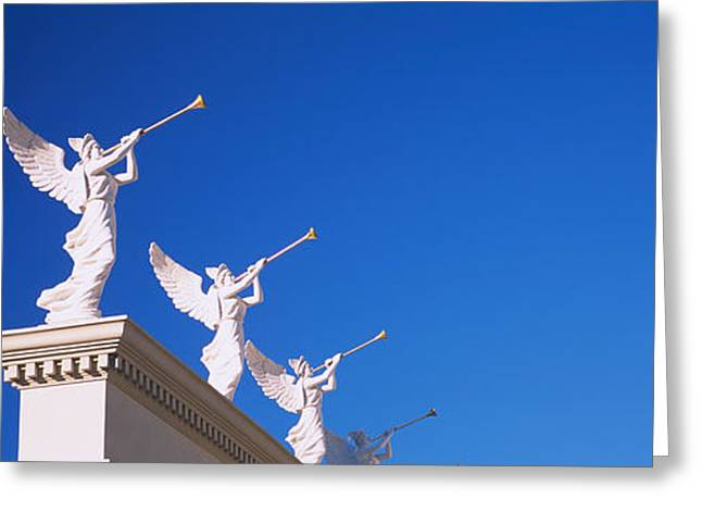 Low Angle View Of Statues On A Wall Greeting Card by Panoramic Images