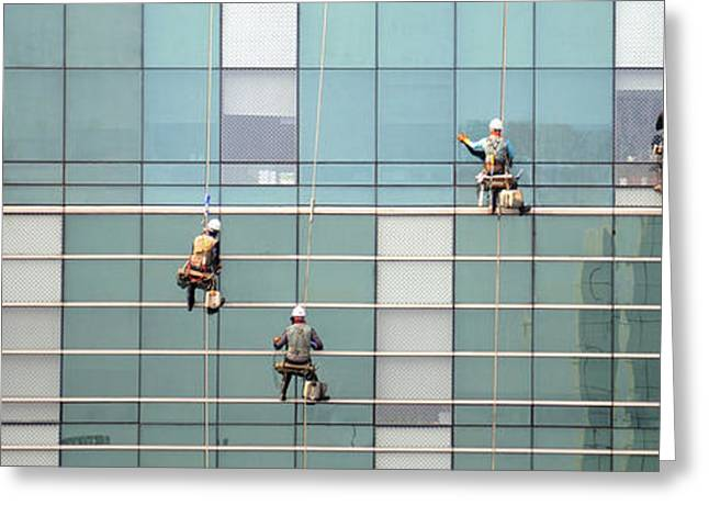 Low Angle View Of Window Washer Greeting Card