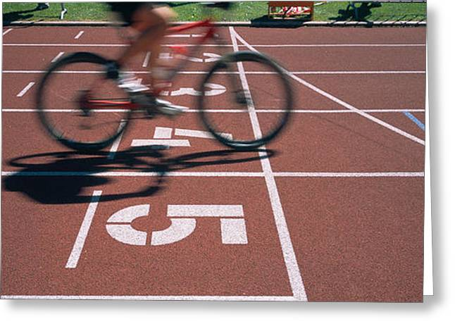 Low Section View Of A Man Cycling Greeting Card by Panoramic Images