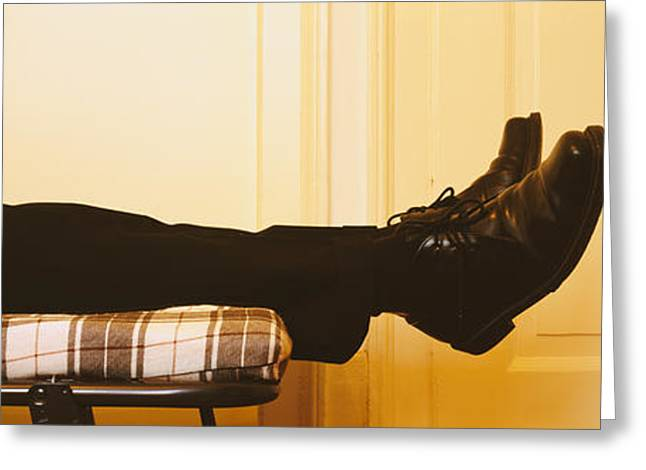 Low Section View Of A Man Lying On The Greeting Card by Panoramic Images