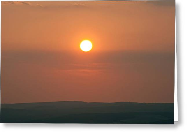 Low Setting Sun Over Distant Landscape Greeting Card by Matthew Gibson