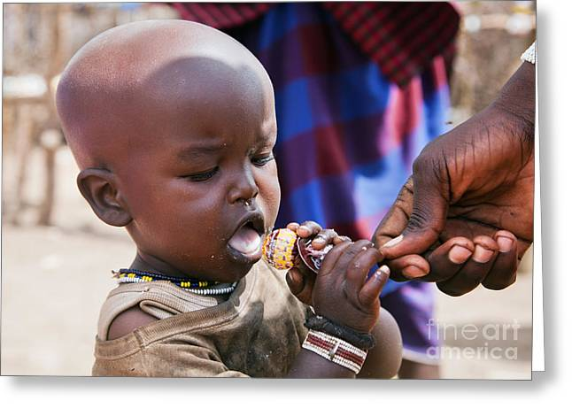 Maasai Child Trying To Eat A Lollipop In Tanzania Greeting Card by Michal Bednarek