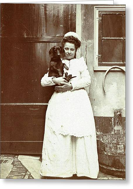 Maid With A Dachshund In Her Arms At An Outside Tap Greeting Card by Artokoloro