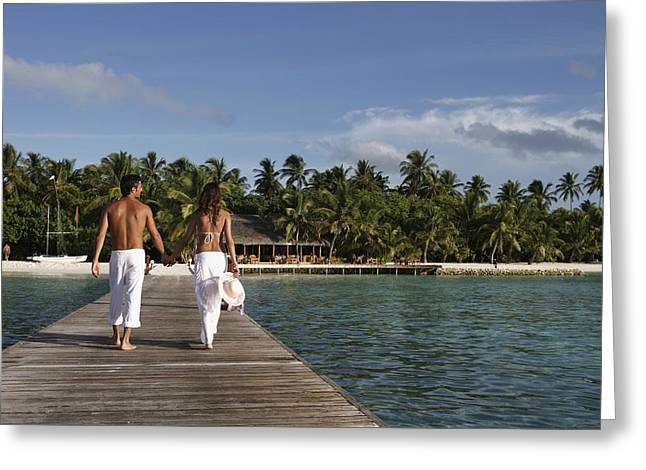 Maldives, Couple Walking On Pier � Greeting Card
