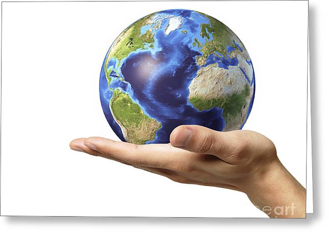 Male Hand Holding Earth Globe Greeting Card by Leonello Calvetti