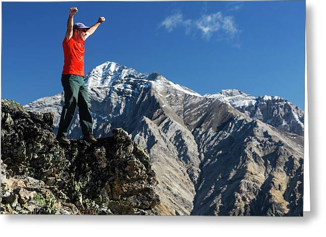 Male Hiker Standing With Arms Raised Greeting Card