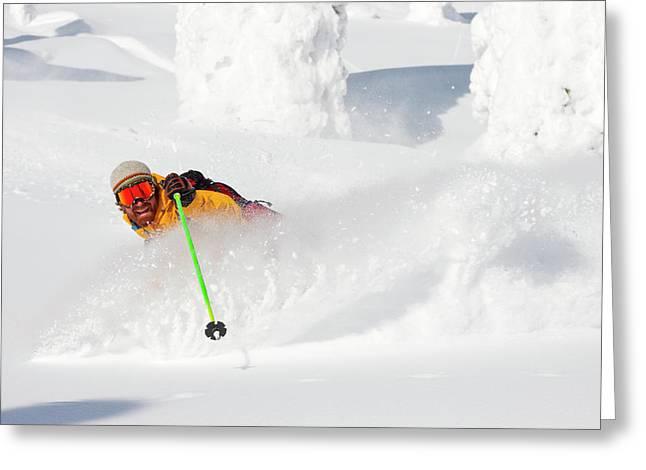Male Skier Makes A Deep Powder Turn Greeting Card