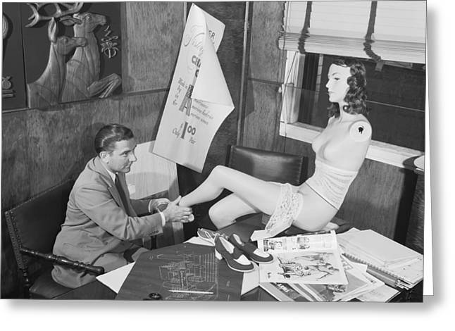 Man Adjusting A Mannequin Greeting Card by Arthur S. Siegel