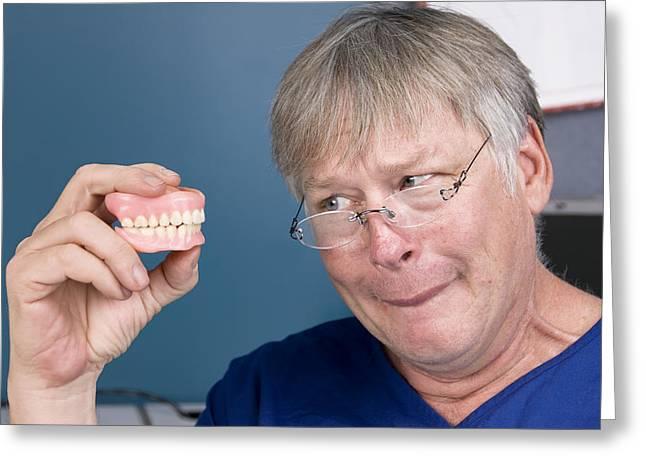 Man And His Dentures Greeting Card by Joe Belanger