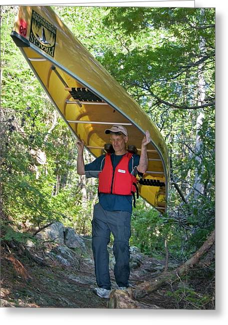 Man Carrying A Canoe Greeting Card