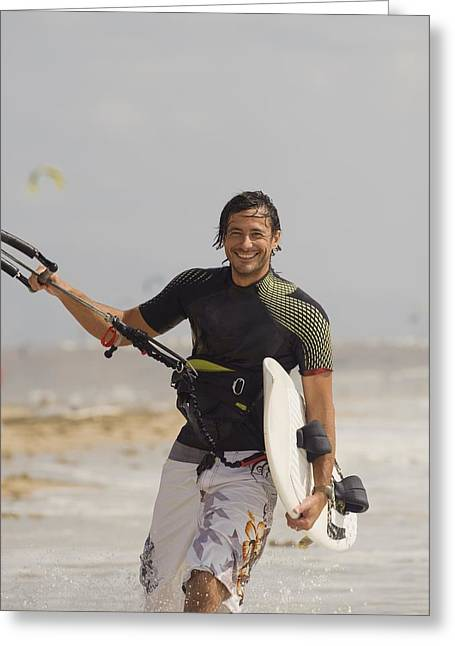 Man Carrying Kitesurfing Board Greeting Card by Ben Welsh
