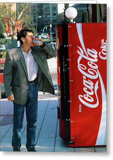 Man Drinking A Can Of Coke Greeting Card by Marcelo Brodsky/science Photo Library