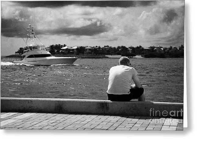 Man Fishing On Mallory Square Seafront Key West Florida Usa Greeting Card by Joe Fox