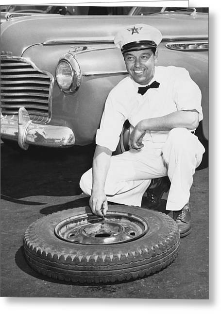 Man Fixing A Flat Tire Greeting Card by Underwood Archives