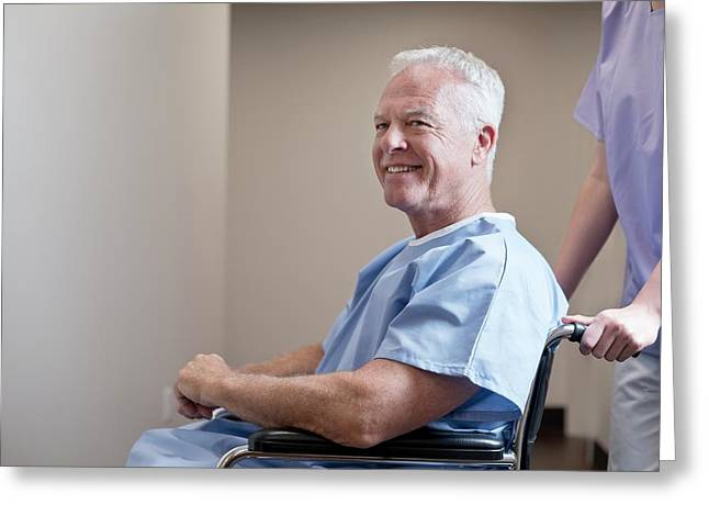 Man In Hospital Gown In Wheelchair Greeting Card by Science Photo Library