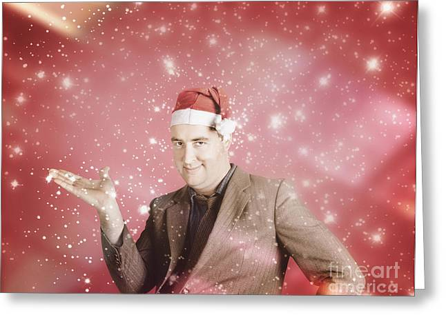 Man In Santa Hat Displaying Christmas Copyspace Greeting Card by Jorgo Photography - Wall Art Gallery