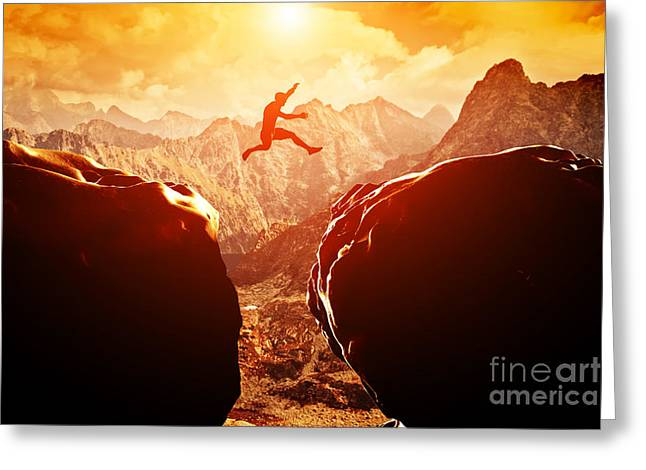 Man Jumping Over Precipice In Mountains Greeting Card