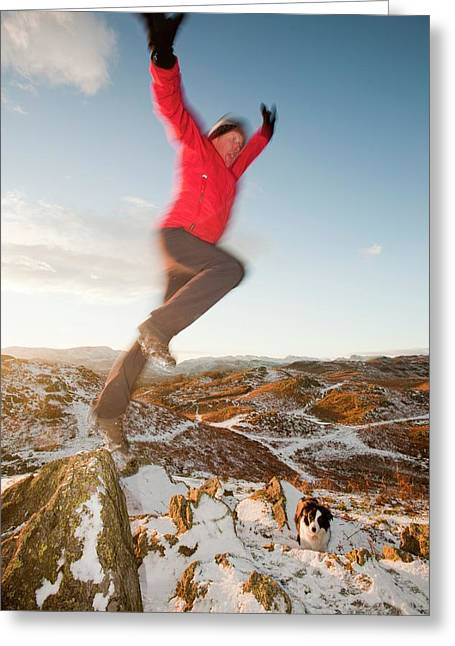 Man Leaping Off Rock Greeting Card