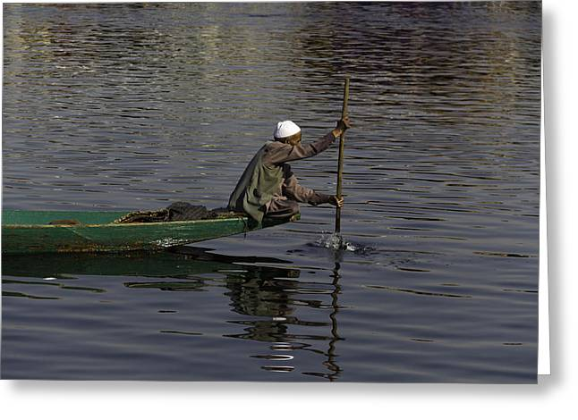 Man Plying A Wooden Boat On The Dal Lake Greeting Card by Ashish Agarwal