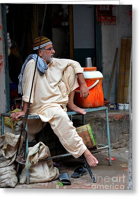 Man Sits And Relaxes In Lahore Walled City Pakistan Greeting Card