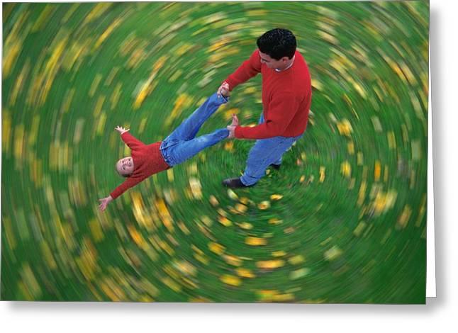 Man Swinging Child Through Air Greeting Card