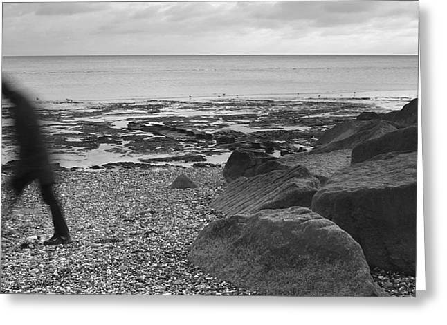 Man Walking Along Pebble Beach - Black And White Greeting Card by Natalie Kinnear
